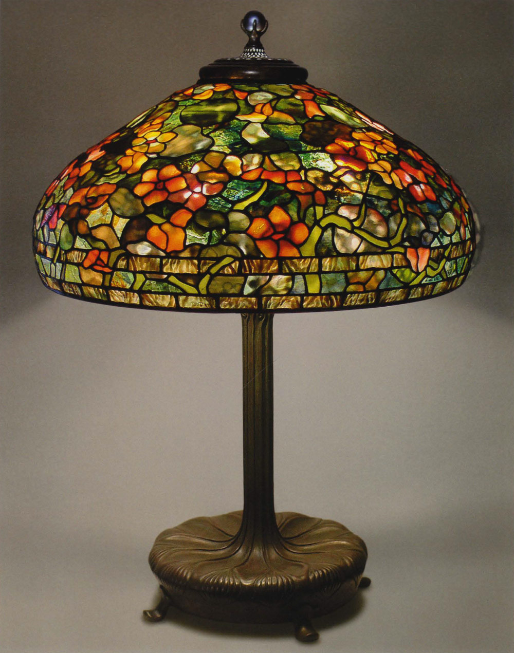 Tiffany studios techniques featured artist the completed lampshade is a 22 nasturtium tiffany studios pattern the shade rests on a large library base with a three light cluster inside keyboard keysfo Image collections